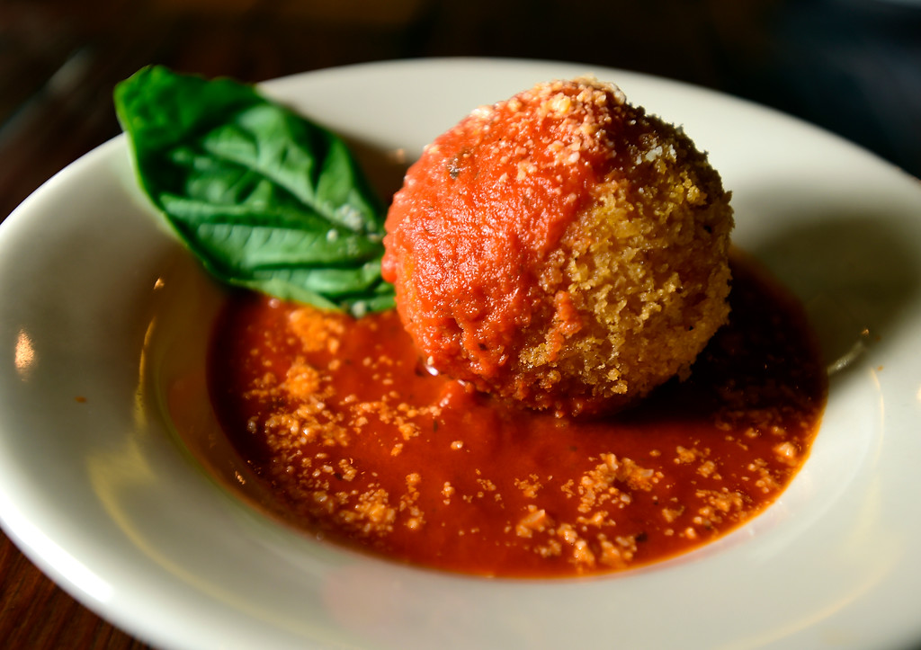 . The Arancini with lighly fried Arborio rice, with peas and Bolognese sauce at Caprese Trattoria on Thursday in Longmont. For more photos of the food go to dailycamera.com Jeremy Papasso/ Staff Photographer/ Oct. 5, 2017