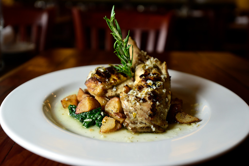 . Pollo Al Carbone with a half semi-deboned farm chicken, with fresh herbs and garlic, charcoal brick pressed on the grill served with roasted potatoes and spinach at Caprese Trattoria on Thursday in Longmont. For more photos of the food go to dailycamera.com Jeremy Papasso/ Staff Photographer/ Oct. 5, 2017