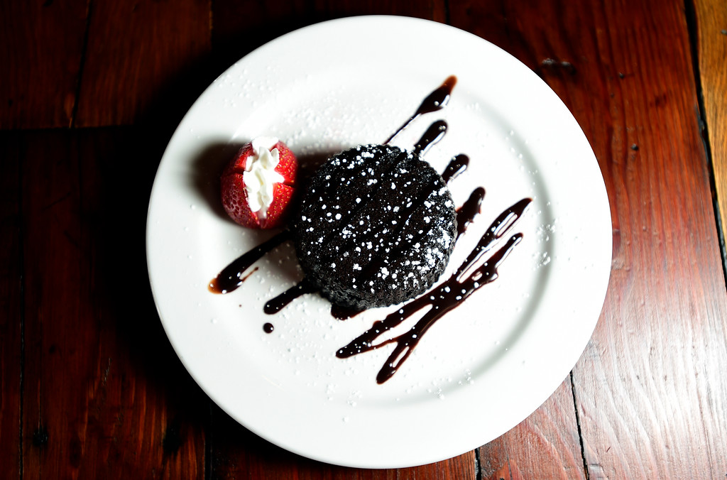 . Torta Cioccolato, a warm gluten-free soft chocolate cake with chocolate sauce and a strawberry at Caprese Trattoria on Thursday in Longmont. For more photos of the food go to dailycamera.com Jeremy Papasso/ Staff Photographer/ Oct. 5, 2017