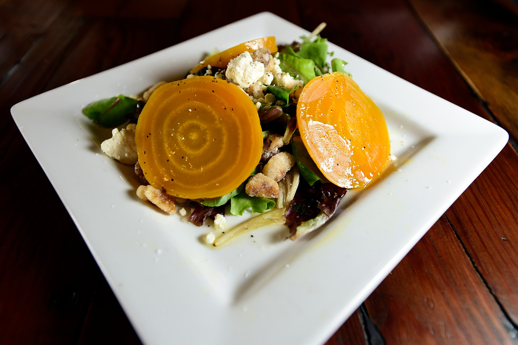. The Rapa with organic greens, roasted golden beets, candied walnuts, gorgonzola cheese with a lemon vinagrette dressing at Caprese Trattoria on Thursday in Longmont. For more photos of the food go to dailycamera.com Jeremy Papasso/ Staff Photographer/ Oct. 5, 2017