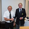 Leslie Bradshaw 5th place prizewinner in the Captain's Prize receives his prize from Captain Jim