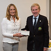 Ruth Henderson, Winner of the Ladies 9-Hole Competition receiving her prize from Captain Jim