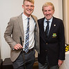 Joe Neiland Jnr Gross Prize winner in the Captain's Prize receives his prize from Captain Jim
