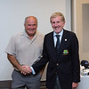 Ruben O'Neill 6th place  prizewinner in the Captain's Prize receives his prize from Captain Jim