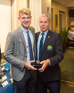 Joe Neiland Jnr. 3rd place in the Captain's Prize  receiving his prize from Captain Kevin