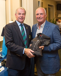 Paul Dean winner of the Best Gross receives his prize from Captain Kevin