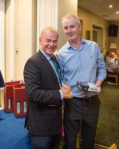 Michael Geraghty Jnr who won Nearest The Pin -15th Hole, receives his prize from Captain Kevin