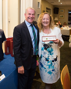 Irene Winters who came 2nd in the Ladies 9-Hole Competition receiving her prize from Captain Kevin
