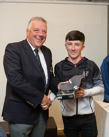 Junior Boys Runner-Up in The Captain's Prize, Andrew Traynor being congratulated by Peter