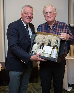 Winner of The Past Captain's Prize, Allister Smith receiving his prize from Peter