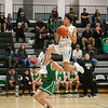 Albuquerque's Jude Tapia, number 12, covers Capital's T.J. Sanchez, number 24, as he goes up for a lay-up during the first quarter of the Capital High School vs Albuquerque High School boys basketball game at Capital on Tuesday, February 12, 2019. Luis Sánchez Saturno/The New Mexican
