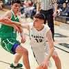 Albuquerque's Austin Perea, number 11, covers Capital's Brandon Saiz, number 12, during the second quarter of the Capital High School vs Albuquerque High School boys basketball game at Capital on Tuesday, February 12, 2019. Luis Sánchez Saturno/The New Mexican