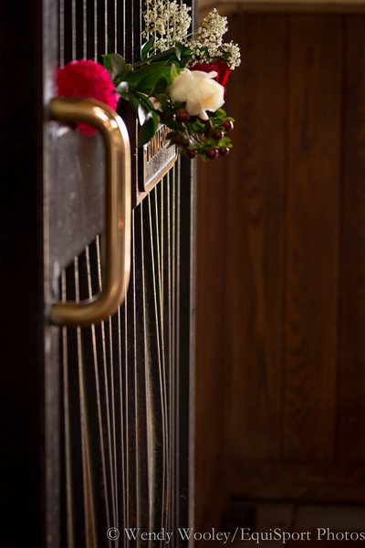 Flowers left on Dynaformer's stall door at Three Chimney's Farm.  Notice the bent bars on his stall door from his antics over the years.  RIP Dynaformer