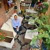 Mark relaxes in his oasis, a private outside deck surrounded by unique flowers and greenery, meticulously groomed by Freddie A.