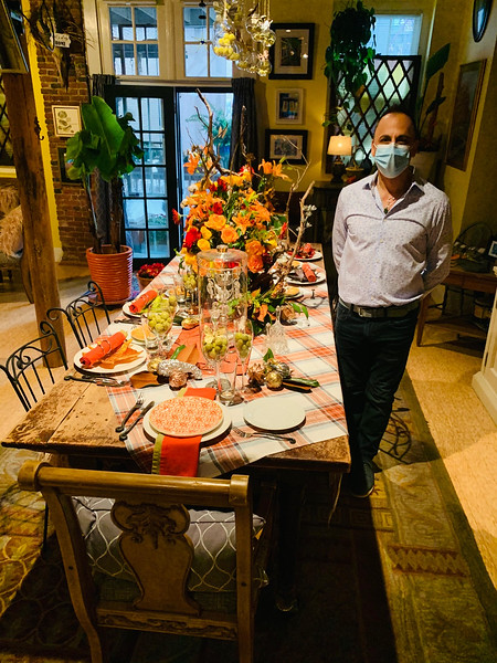 Mark Caputo shows his masterpiece -- a table full of memories of collectible glass, silverware,flatware and candelabras, cloth napkins, decorations of acorns and more.