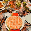 Vibrant colors of orange ,pea green and red flatware handed down by Mark's mom, Carole Caputo
