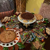 The dessert table is filled with delectable traditional pies.