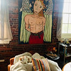 Behind Khristian, the adorable ca,t hangs a portrait of Archangel Gabriel painted by Pamela Dixon.