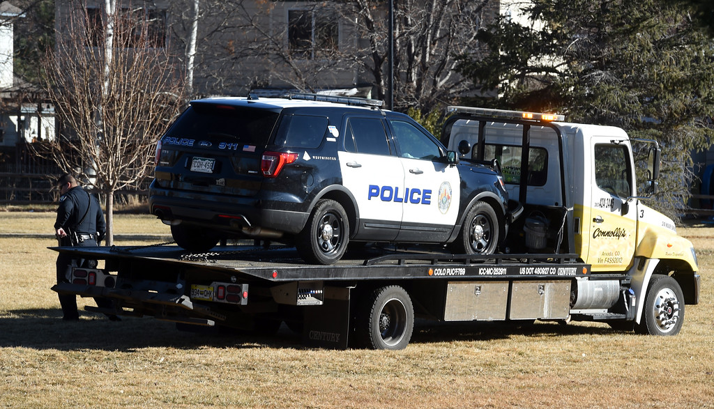 ". A damage police vehicle is towed away from the scene.  A five-agency search for an ""armed and dangerous man\"" concluded around 1:15 p.m. Thursday on Elk Court in Broomfield near Lowell Boulevard and 136th Avenue. The suspect, identified the man as Eric Winden, 35, was cornered in the back yard of a home with the assistance of K9 units.  Cliff Grassmick  Photographer January 11, 2018"