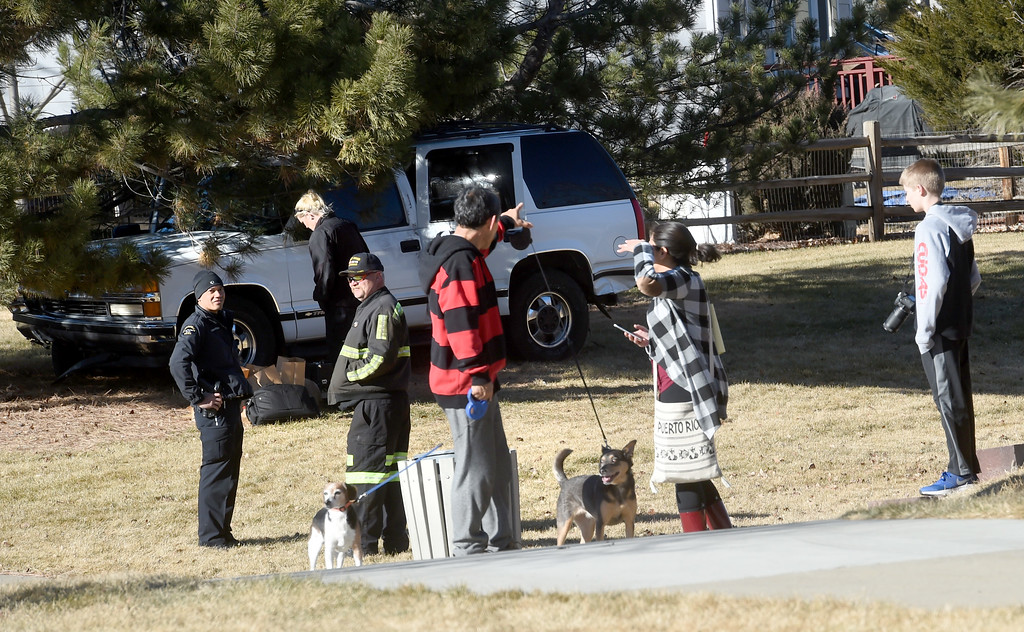 ". Curious people come up to the crime scene.  Police continue to collect evidence after the suspect was arrested. A five-agency search for an ""armed and dangerous man\"" concluded around 1:15 p.m. Thursday on Elk Court in Broomfield near Lowell Boulevard and 136th Avenue. The suspect, identified the man as Eric Winden, 35, was cornered in the back yard of a home with the assistance of K9 units.  Cliff Grassmick  Photographer January 11, 2018"