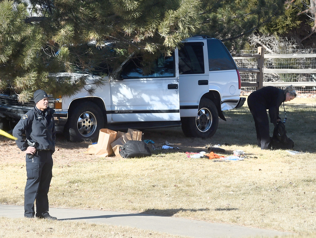". Police continue to collect evidence around the suspect\'s SUV after the suspect was arrested. A five-agency search for an ""armed and dangerous man\"" concluded around 1:15 p.m. Thursday on Elk Court in Broomfield near Lowell Boulevard and 136th Avenue. The suspect, identified the man as Eric Winden, 35, was cornered in the back yard of a home with the assistance of K9 units.  Cliff Grassmick  Photographer January 11, 2018"