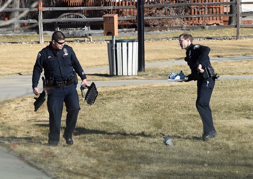 ". Police continue to collect evidence, including pieces of vehicles,  after the suspect was arrested. A five-agency search for an ""armed and dangerous man\"" concluded around 1:15 p.m. Thursday on Elk Court in Broomfield near Lowell Boulevard and 136th Avenue. The suspect, identified the man as Eric Winden, 35, was cornered in the back yard of a home with the assistance of K9 units.  Cliff Grassmick  Photographer January 11, 2018"