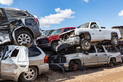 Butchered cars,  old tires. Car junkyard. Car wrecks.