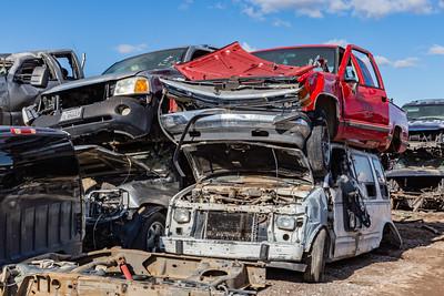 Close up car junk. Butchered cars,  old tires. Car junkyard. Car wrecks.