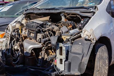 Close up totalled car. Butchered cars,  old tires. Car junkyard. Car wrecks.