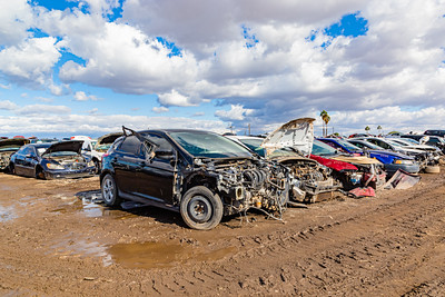 Car wrecks. Junk. Car junk. Totalled cars. Junkyard