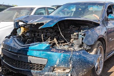 Butchered cars,  old tires. Car junkyard. Car wrecks.