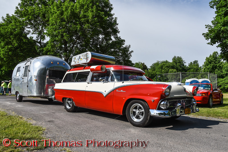 1955 Ford Ranch Wagon and 1964 Airstream Bambi II travel trailer pulling into the All Ford Cruise In and Swap Meet at Longbranch Park near Liverpool, New York on Sunday, June 10, 2018.