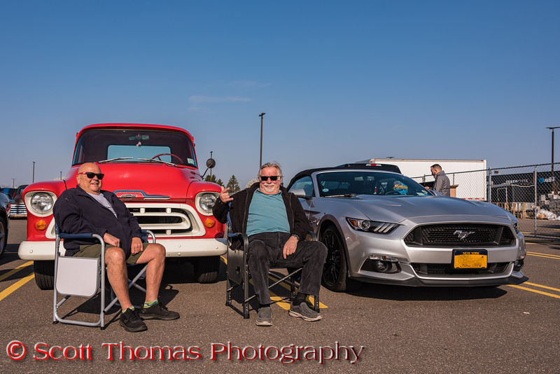 Friends hanging out together at the Rt. 31 Cars & Coffee near Wegmans in Clay, New York on Saturday, April 24, 2021.