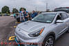 People interested in a 2020 Kia Niro EV during the Cars, Coffee & EVs near Wegmans in Clay, New York on Saturday, September 18, 2021.