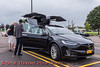 People interested in a Tesla Model X during the Cars, Coffee & EVs near Wegmans in Clay, New York on Saturday, September 18, 2021.
