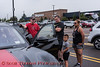 People interested in a Ford Mustang Mach-E during the Cars, Coffee & EVs near Wegmans in Clay, New York on Saturday, September 18, 2021.