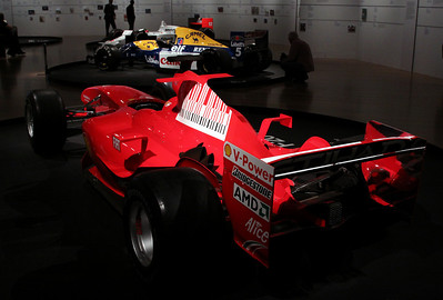 Ferrari F2004 (2004), and in the background is the Williams FW14B (Nigel Mansell, 1992)