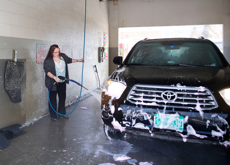HOLLY PELCZYNSKI - BENNINGTON BANNER Gail Stickle, of Bennington washes her car on Tuesday morning in Bennington.