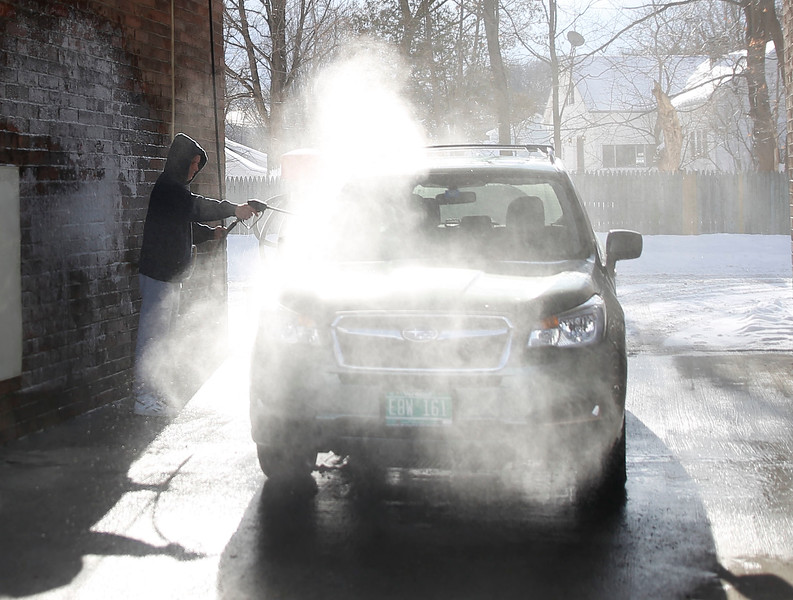 HOLLY PELCZYNSKI - BENNINGTON BANNER Tom Dykemen, of Sunderland removes salt and snow from his car on Tuesday morning at Martin's East Side Laser Wash in Bennington.