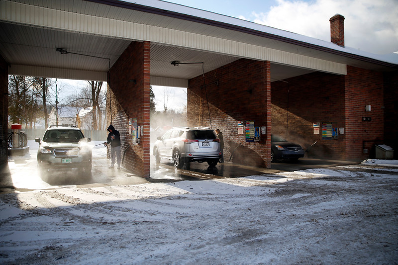 HOLLY PELCZYNSKI - BENNINGTON BANNER Warmer temperatures bring car owners out on Tuesday afternoon to wash their cars.
