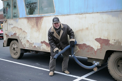 Bob Boston re-enacts the famous scene in the movie where Randy Quaid empties the contents of the black water tank into the storm sewer....