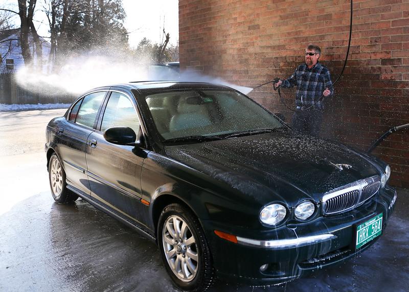 HOLLY PELCZYNSKI - BENNINGTON BANNER Gary Bullock, of Bennington washes his car on Monday afternoon at Martin's East Side Laser Wash in Bennington.