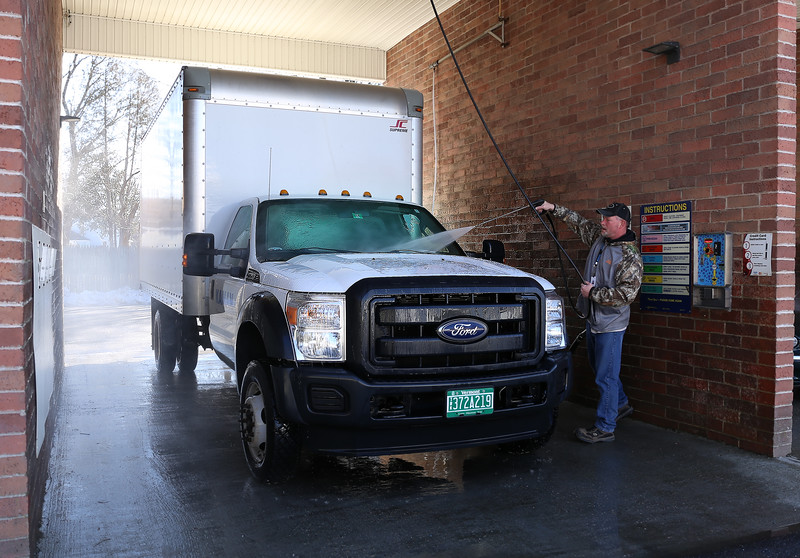 HOLLY PELCZYNSKI - BENNINGTON BANNER Shane Green, of Bennington washes his company truck  on Monday afternoon at Martin's East Side Laser Wash in Bennington.