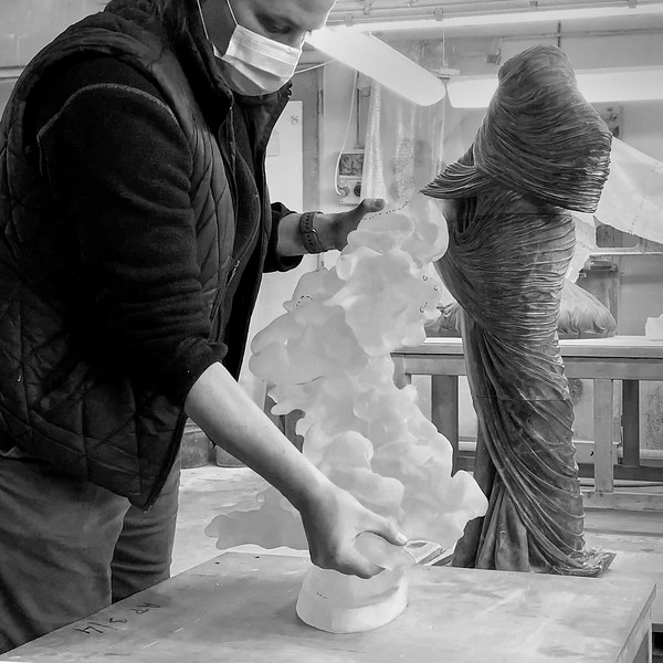 Working on Cumulus cloud sculpture in cast glass.  <br> Nocturne sculpture in the background.