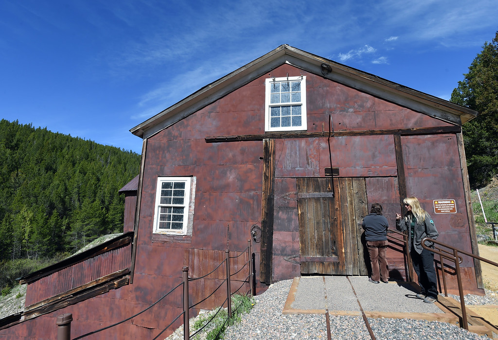 . Sheryl Kippen, left, and Carol Beam, of Boulder County Parks and Open Space, are about to enter the top part of the mill. The Cardinal Mill, outside of Nederland, is being historically preserved. Cliff Grassmick  Photographer  May 29,  2018