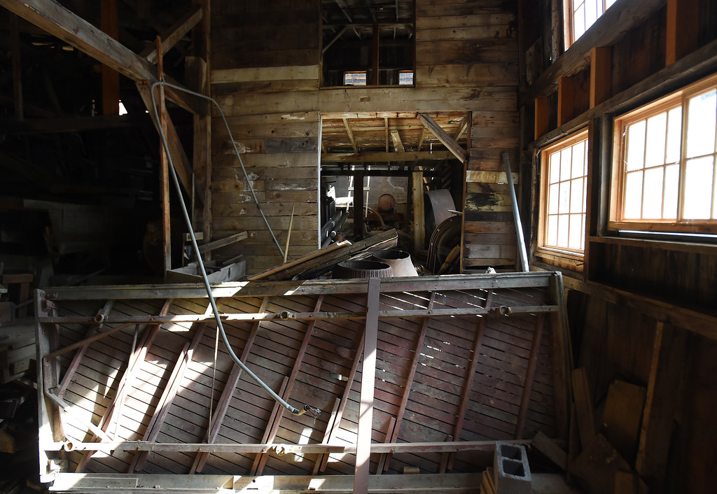 . The inside of the mill is a web of old wood and metal. The Cardinal Mill, outside of Nederland, is being historically preserved. Cliff Grassmick  Photographer  May 29,  2018