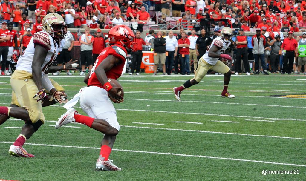 Lamar Jackson runs past the Seminoles