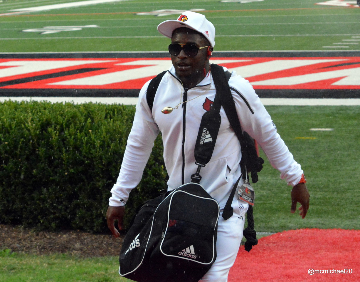 Brandon Radcliff enters the football complex at end of CardMarch