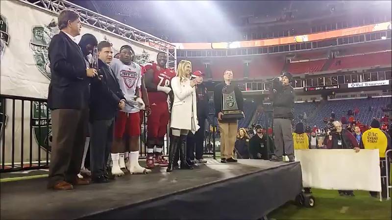 Louisville receives Music City Bowl trophy