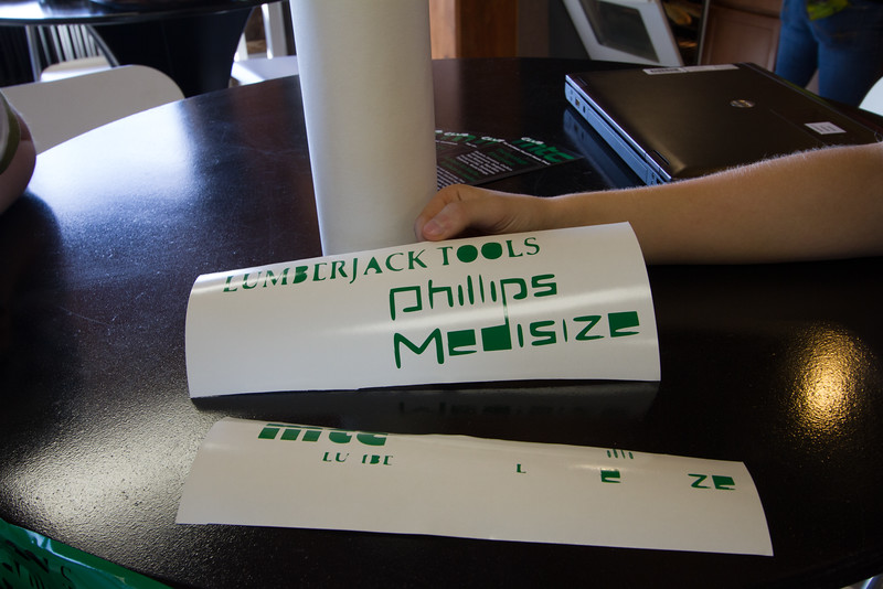 Leaning to use the vinyl cutter to create the sponsor logos to be placed on the robots.